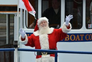 Santa waving on a Charles Riverboat coming into Cambridge, MA