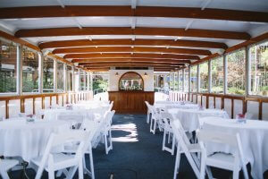 tables set on board vessel with a bar