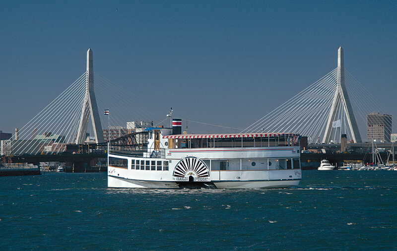 charles riverboat lexington with the zakim bunker hill memorial bridge