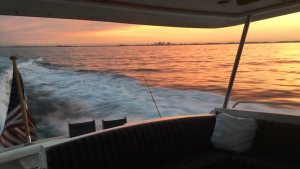 boston skyline view from a boat at dusk