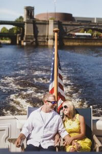 couple smiling on board boat cruise