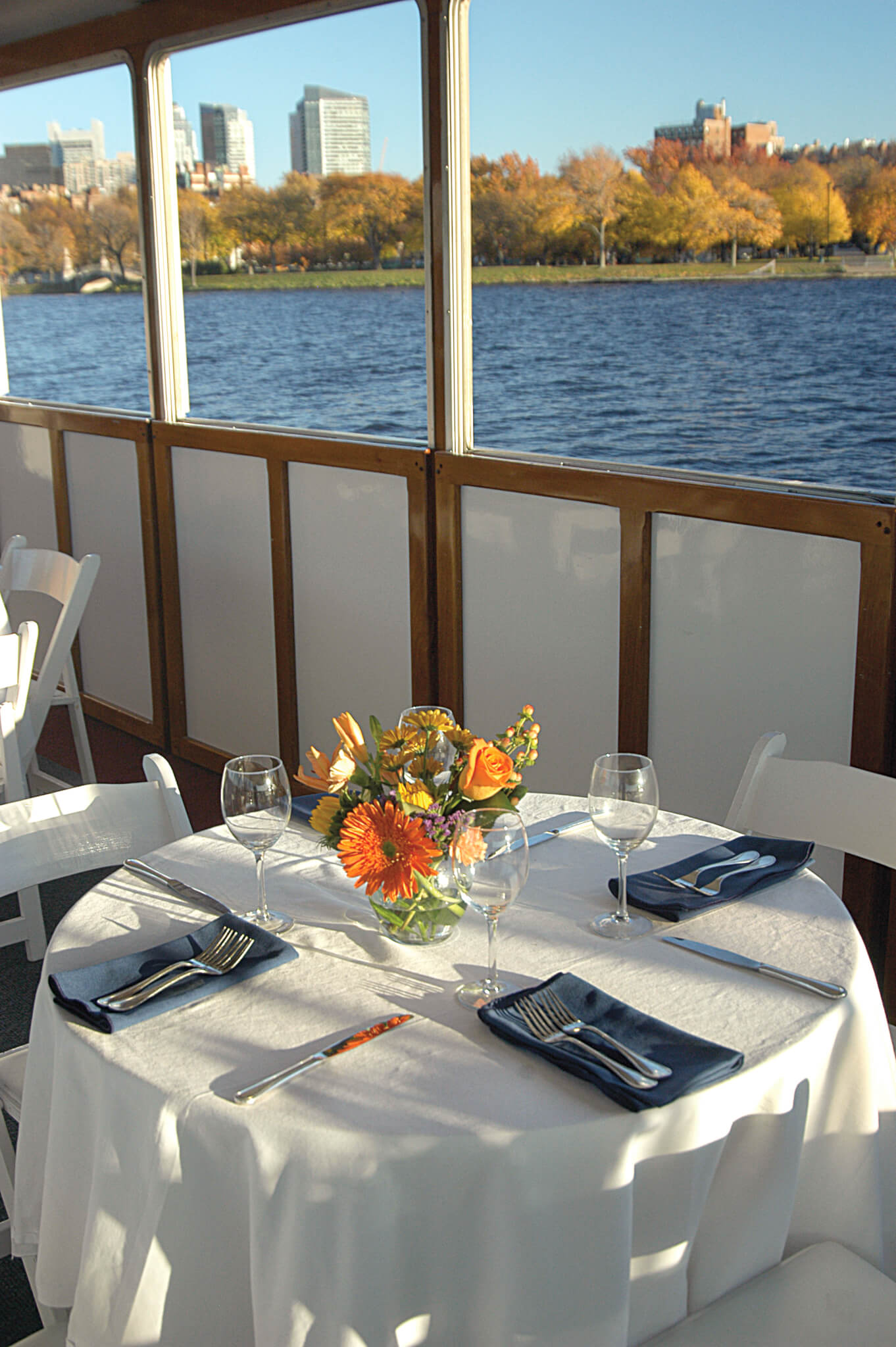 table for 4 set on board vessel with a view of boston
