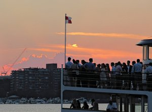 people watching the sunset from a charles riverboat vessel