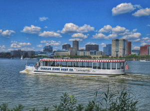 charles riverboat company boat with boston skyline behind