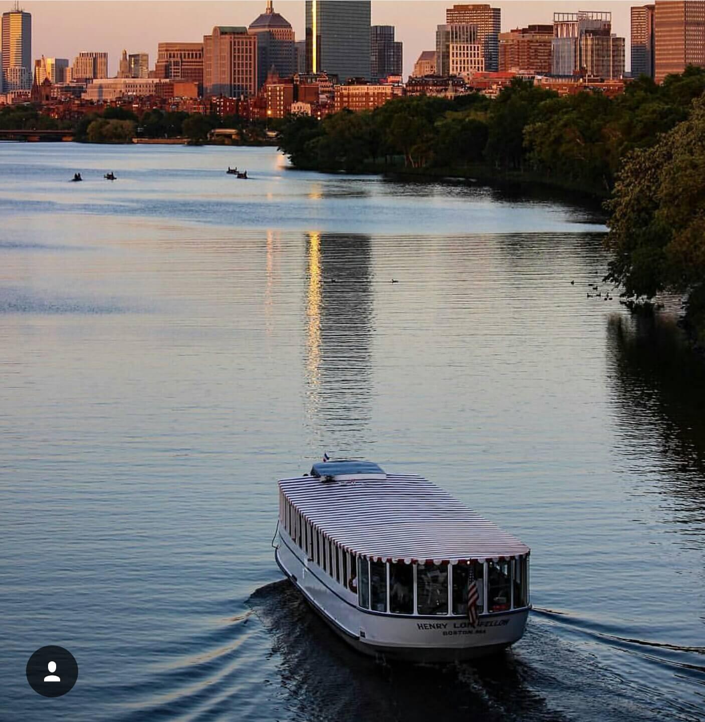 henry longfellow cruising towards boston skyline