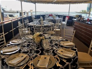 dining tables set with menus on board vessel
