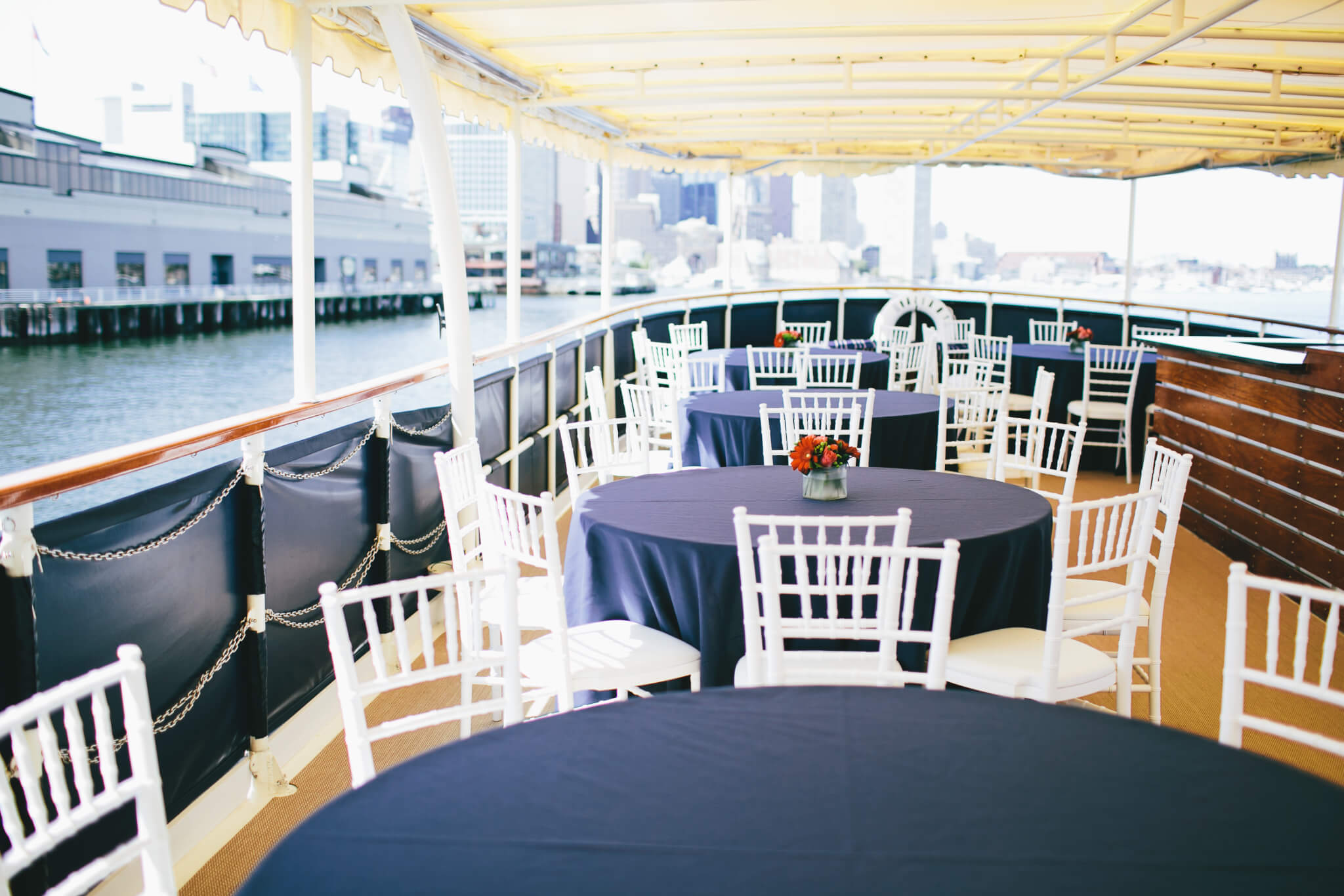 tables set on board the charles riverboat valiant