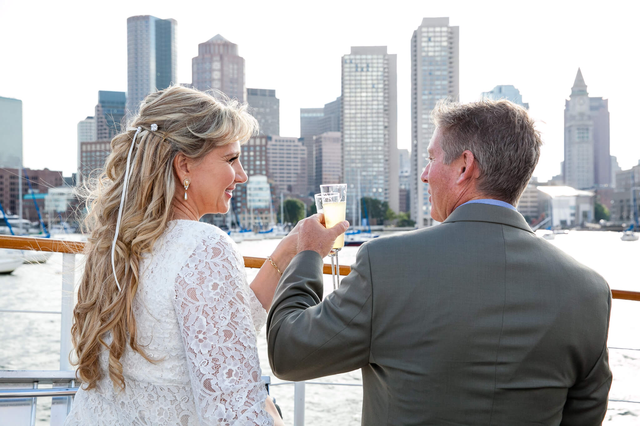 bride and groom toasting on the ship