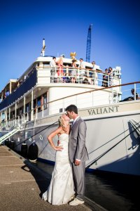 bride and groom kissing in front of the valiant