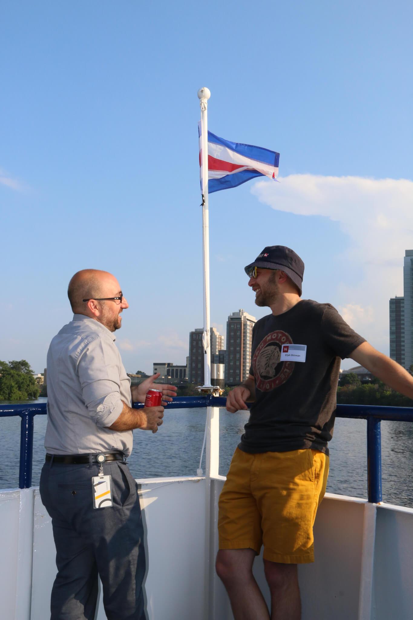 men talking on board ship