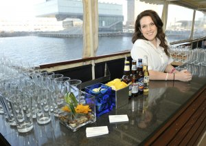 smiling bartender behind the bar on board vessel