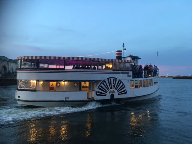 charles riverboat lexington at dusk