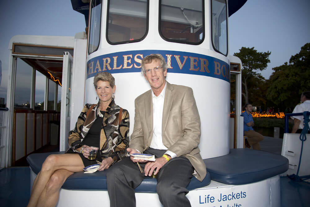 couple posing on board private charter event