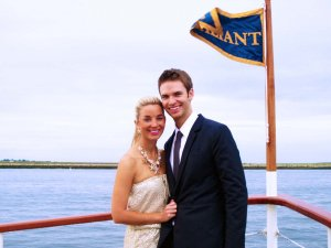 couple posing on board the valiant with flag