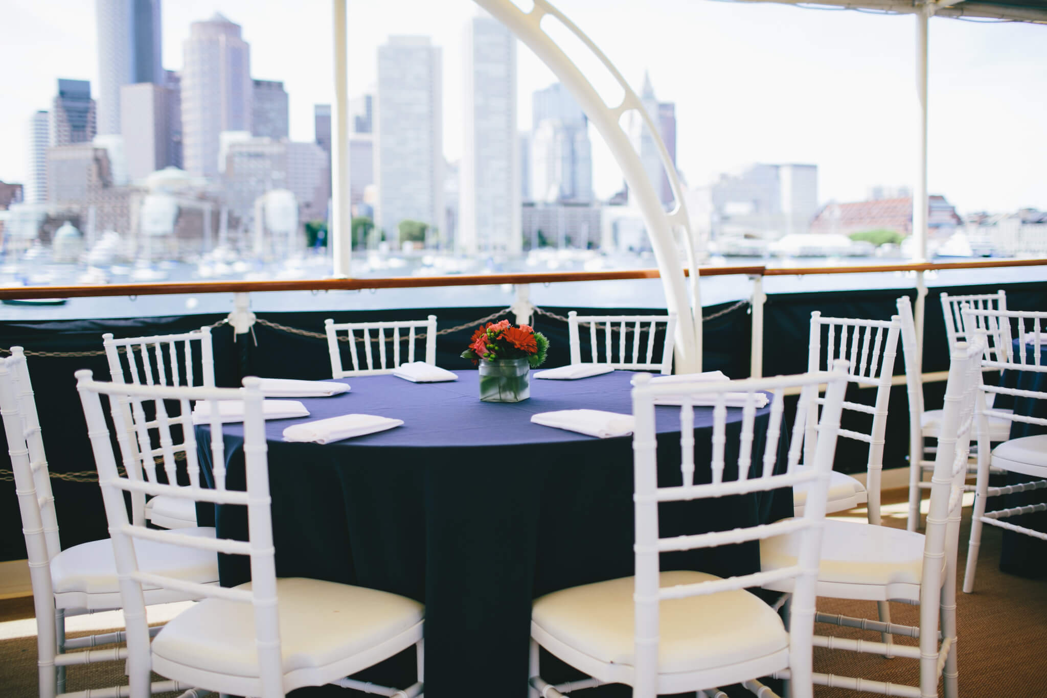 a set table on the valiant with boston skyline in view