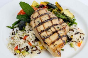 grilled chicken over rice with vegetables