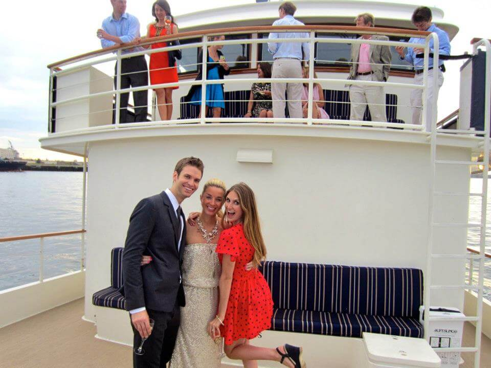 people posing on board a private event