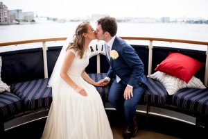 bride and groom kissing on the valiant