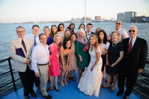 bride posed with family on ship