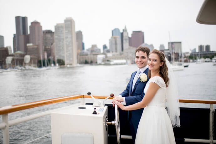 bride and groom steering boat