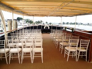 chairs set for a wedding on board the valiant