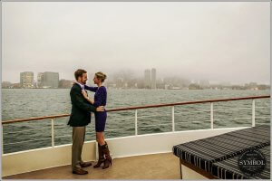 couple on a cruise on a foggy day in boston