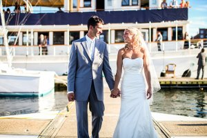bride and groom walking on the dock