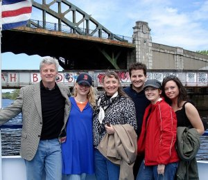 people posing on board a charles riverboat company vessel
