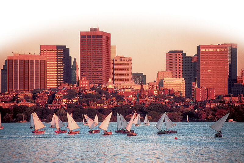 boston skyline from the water with sailboats