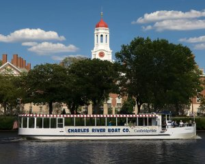 a charles riverboat company vessel in front of boston sightseeing spot