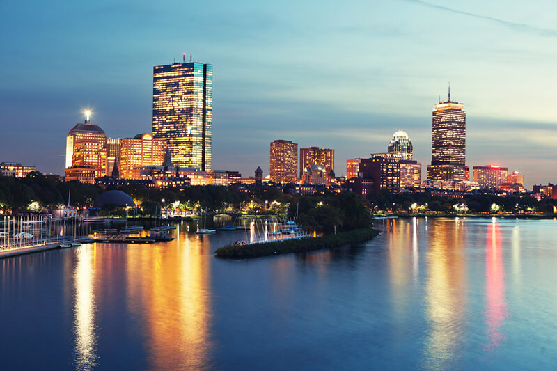 boston skyline across the water at dusk