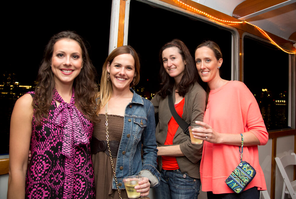 women at event onboard a boat