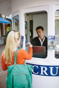 blonde woman buying ticket for a charles riverboat tour