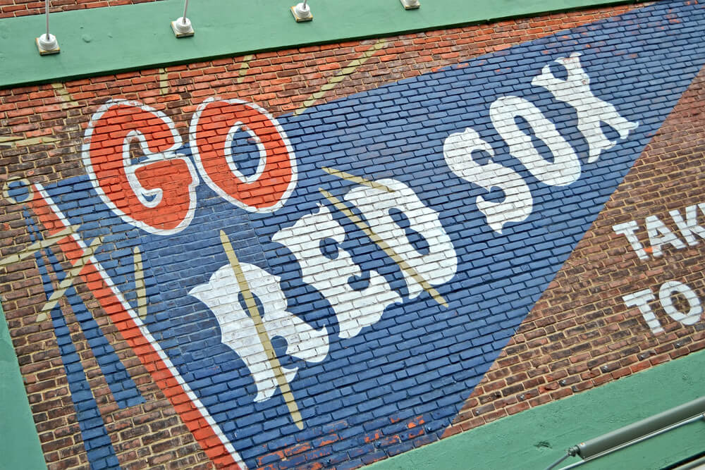 Go Red Sox painted on the wall in Fenway