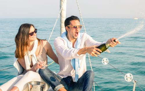 couple on boat with champagne