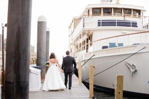 couple walking on the dock