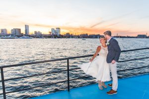 couple getting married at sunset